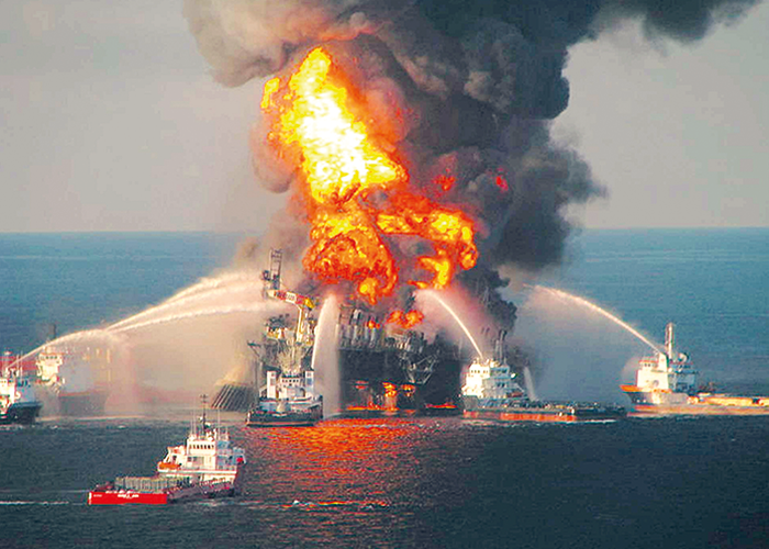 Emergency services extinguishing the explosion in the Deepwater Horizon Oil Spill in 2010.