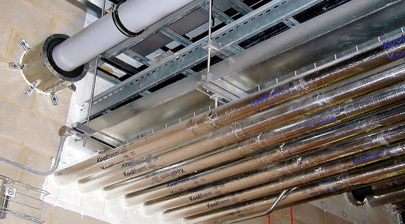 Service pipes and cable systems correctly specified and fitted with suitable fire stopping products through a compartment wall, the work in this case carried out by a third party certified installation company.