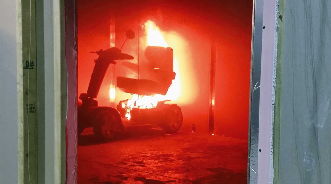 The seat of the mobility scooter catches fire during Experiment 1.
