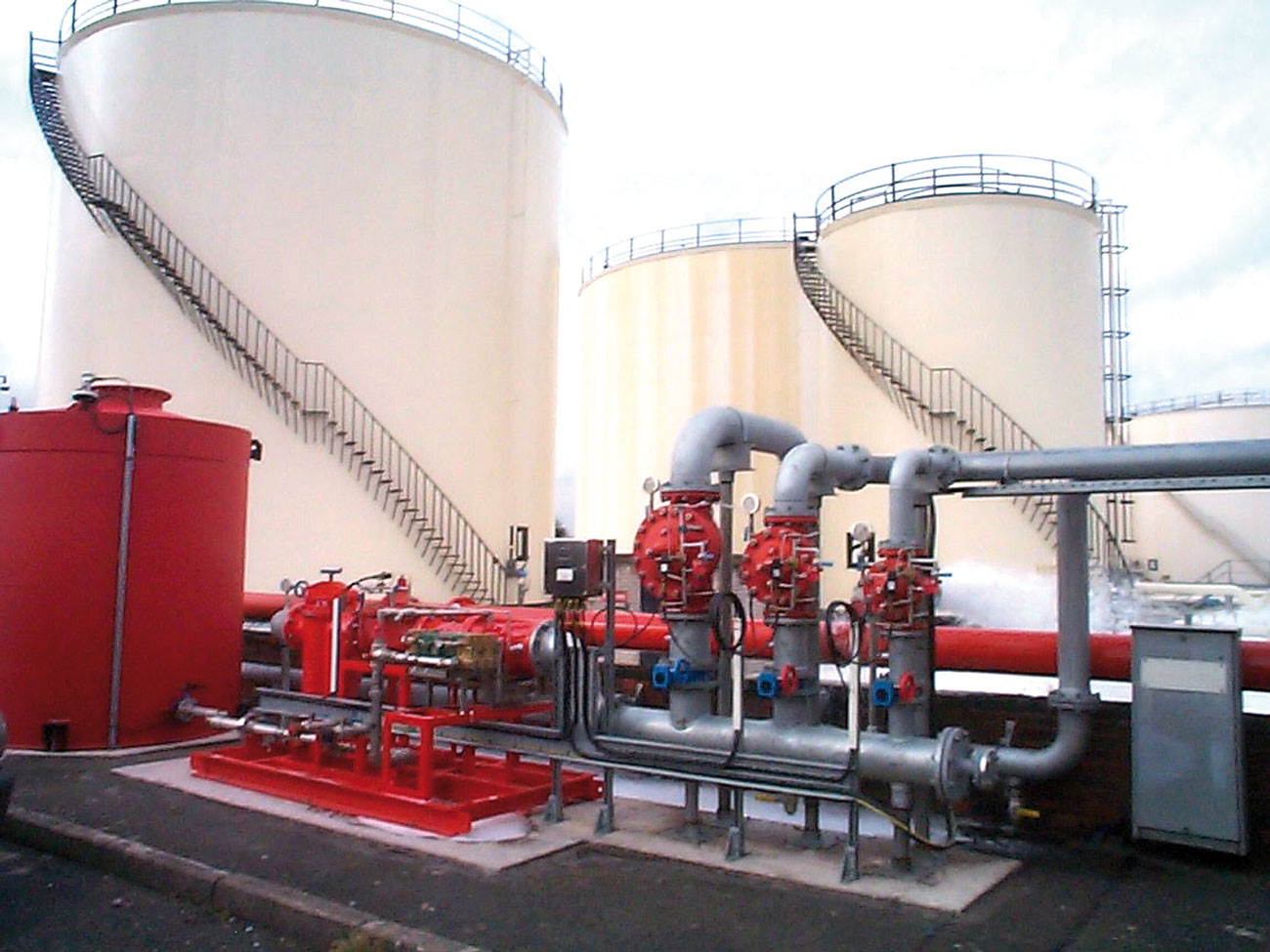 Fig. 4: Tank farm with water motor driven proportioning pump and foam concentrate container.