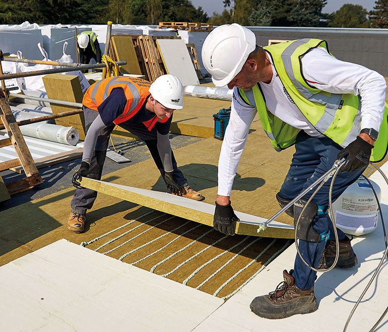 Southern Industrial Roofing installs non-combustible stone wool insulation at Cobham Free School, Surrey.