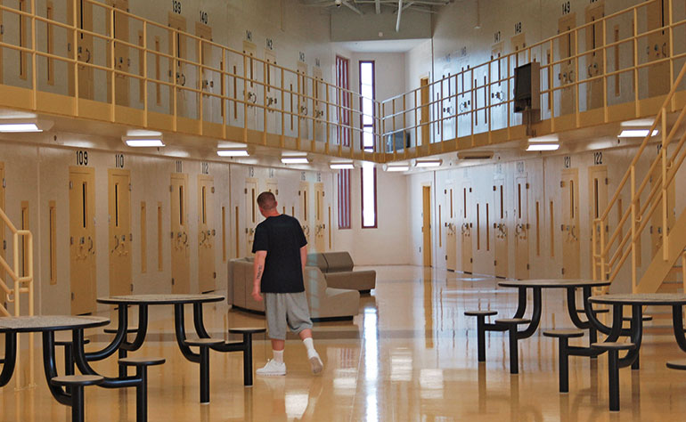 The interior of a typical prison with a day room.