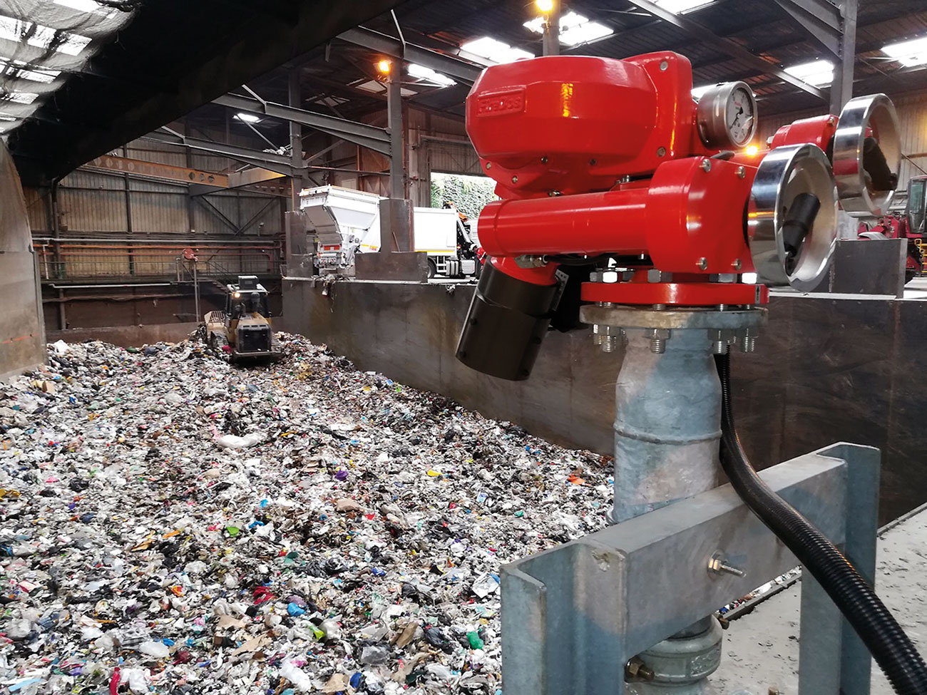 Figure 1: Remote controlled FireDos M2 fire monitor with manual backup on standby in recycling facility.