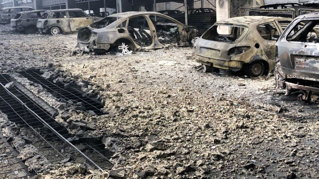 A view of burnt out vehicles and spalled concrete on the multi-story Liverpool Park Garage near the Echo Arena in Liverpool, UK which was destroyed by fire on New Year's Eve 2017.